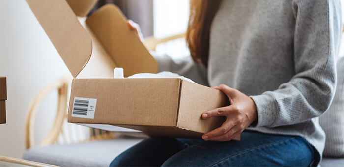 Woman opening packaging box